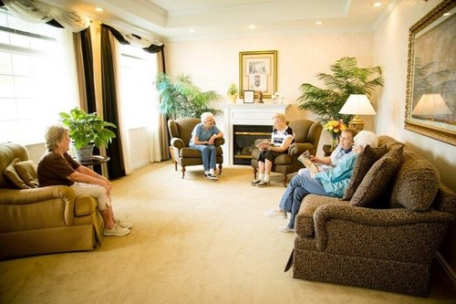 Residents socializing in a spacious living room.